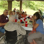 Jim Dunkley enjoys picnic and conversation with his young kin folks.