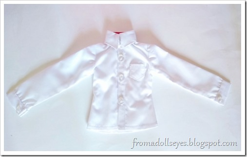 A white button down shirt for a msd or 1/4 scale ball jointed doll, bought from Alice's Collections.  Unwrapped and ready to try on the doll