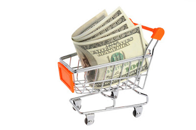 Money in shopping cart isolated on white a background