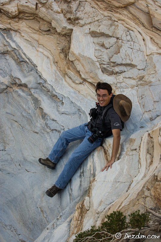 Guy has a little fun sliding down some marble as we hike out of the canyon.