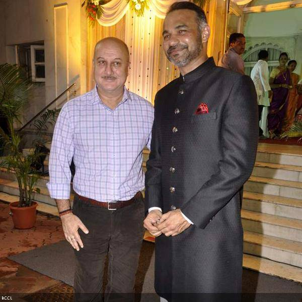 Anupam Kher with director Abhinay Deo at Ramesh and Seema Deo's 50th wedding anniversary, held at ISKCON, in Mumbai, on July 1, 2013. (Pic: Viral Bhayani)