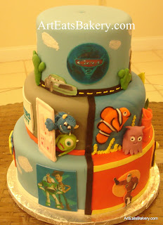 Disney - Pixar kid's birthday cake with Cars, cacti , finding Nemo, Monsters Inc. Toy Story and the Incredibles