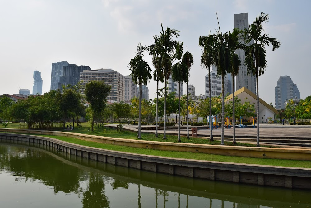 The park has a nice little lake, filled with fish, and an elevated walkway going through the middle of the lake!  From here are nice views of the BKK skyline...