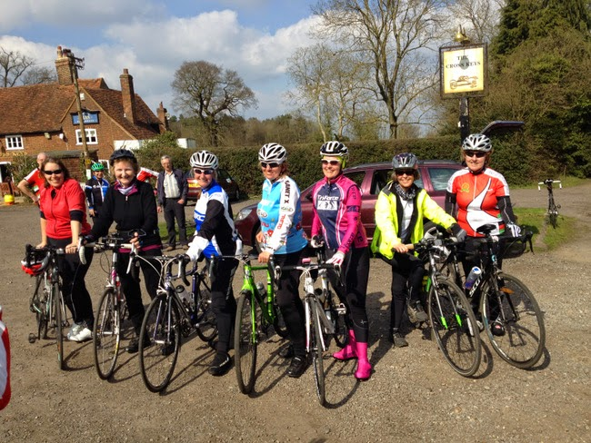 Seven female cyclists posing in a row