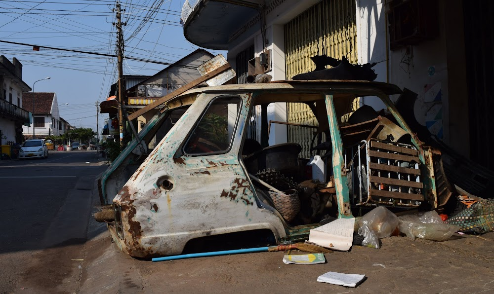 A hollowed-out car skeleton on the mean streets of Savannakhet...
