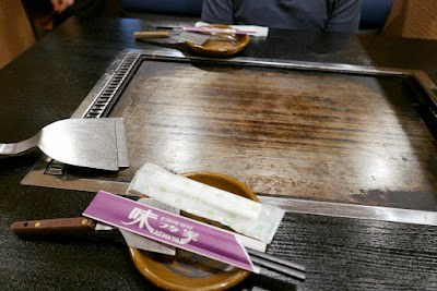 Our booth for two for a dinner of okonomiyaki in Namba, Osaka at Ajinoya.