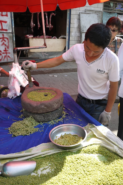 man grinding and selling fresh qingke in Xining, China