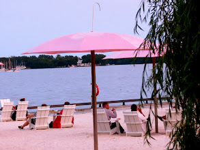 Photo: Along waterfront, a narrow strip of land converted to beach use during the summer