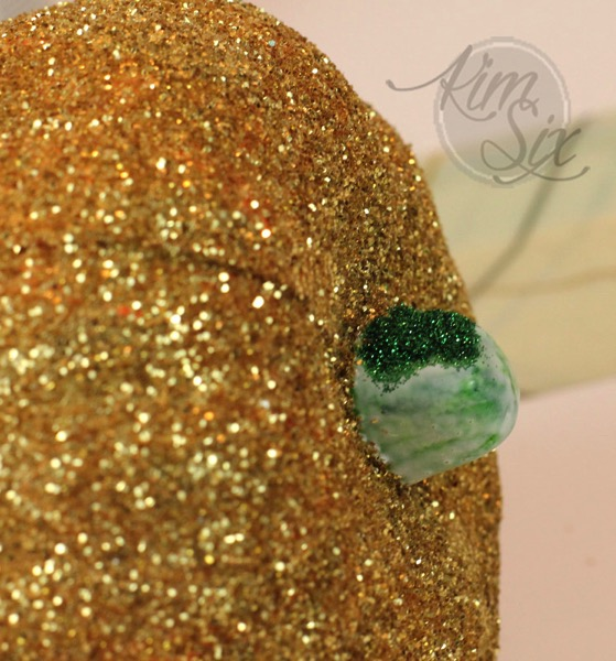 Adding green glitter to pumpkin stem
