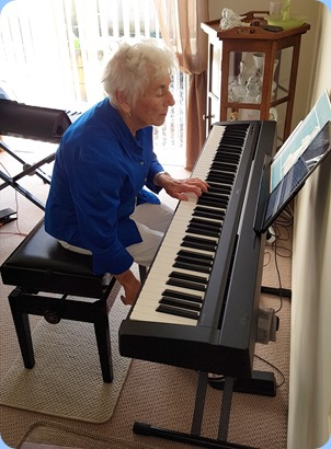Audrey Henden giving the digital piano a whirl.