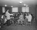 MLK Meeting April 24, 1956 Rev. Martin Luther King, Jr., holds a meeting with the executive board of the Montgomery Improvement Association, after orders were issued to end segregation by the Montgomery City Lines following a successful five-month bus boycott April 24, 1956. (AP/Wide World Photos)