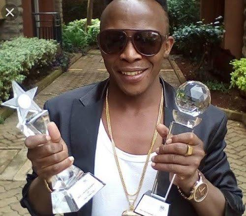 Papa Dennis holding awards. PHOTO | STAR