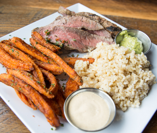 overhead photo of Tri-tip with brown rice and sweet potato fries