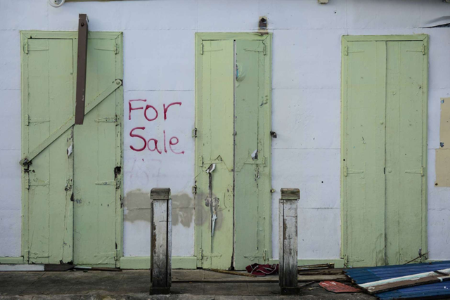 This Friday, 19 January 2018 photo, shows one of multiple properties located in the Esperanza sector that are currently for sale, in Vieques, Puerto Rico. Hundreds of thousands of Puerto Ricans face losing their homes upon the expiration of a three-month moratorium on mortgage payments that banks offered after Hurricane Maria devastated the island. Photo: Carlos Giusti / AP Photo
