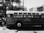 The driver is alone on his empty bus as he moves along downtown Montgomery, April 26, 1956.  African Americans continue to boycott Montgomery City Lines even though the bus company has ordered an end to segregation.  Meanwhile, police have threatened to arrest anyone trying to integrate on buses.  (AP Photo/Horace Cort)
