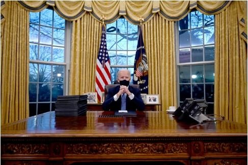 See First Photos Of President Biden Resuming At Oval Office After His Inauguration
