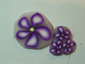 Photo: Violet Flower Cane. 2oz Violet or Purple, 2 oz White and 2 oz Translucent (I use 1oz Fimo and 1oz Sculpey mix). 1/2 oz yellow. Second day 2nd project.