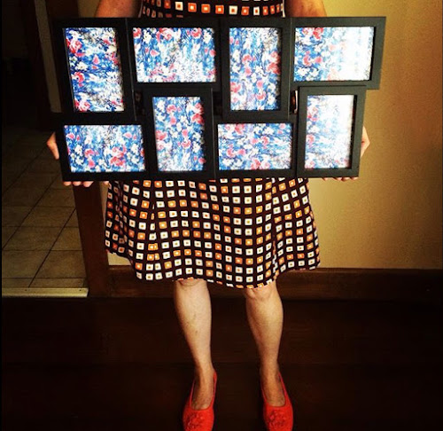 Camille holding a conjoined photo frame filled with blue floral print
