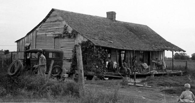 """Lawrence's home when we visited them, 1937."" Tenant farm family on the house porch and in the surrounding yard."