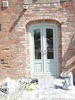 A 3 centred arch doorset with a pair of doors hung