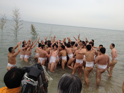Participants celebrate after making it into the sea