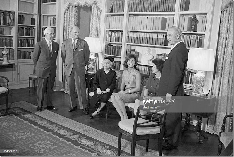 First Lady Jackie Kennedy sits with officials of the American Institute of Interior Design in the White House ground floor library. The Institute sponsored the refurbishment of the library, now in keeping with the 18th century-style of the White House. | Location: Library, White House, Washington, D.C., USA.