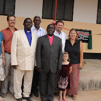 The missionaries in Magambua pose with the Bishop, Assistant Bishop, and General Secretary.