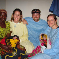 Erin, Jon, Kim, and the mother's friend holding the new twins right after delivery