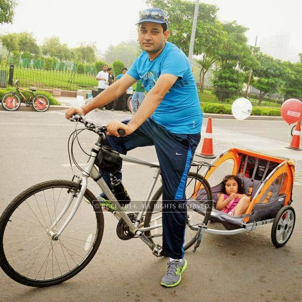 Amit Bhatt, a regular Gurgaon Raahgir, cycles with his  daughter Avira in CP.