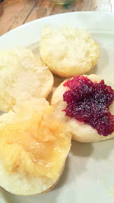 Warm angel biscuits, topped with sorghum butter and a sassafras cranberry and quince sauce