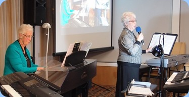 Julia Bissett singing with Dorothy Waddel accompanying on the Clavinova. Photo courtesy of Dennis Lyons.