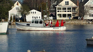 Santa arriving by lobster boat