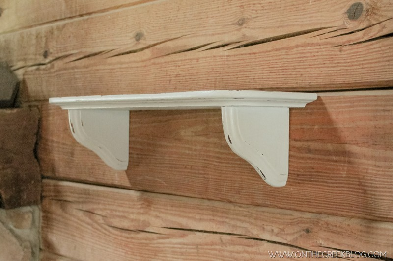 White distressed shelf painted with homemade chalk paint!
