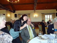 44th Charter Lunch 12th October 2014 Cumberwell Park Golf Club Maureen of Adagio Singers serenading one of our guests.