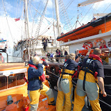 21 August 2011 - Training with the Jubilee Sailing Trust's ship Tenacious - passing over a stretcher with our casualty 'dummy' strapped inside. Photo: RNLI Poole/Dave Riley