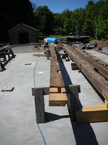Three of the barns four tie beams had severe rot at both ends.  We decided to shift the joinery and scarf only one new end to these ties.