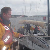 Poole crew swapping over ropes as they came into calmer waters. Photo: RNLI Poole/Anne Millman