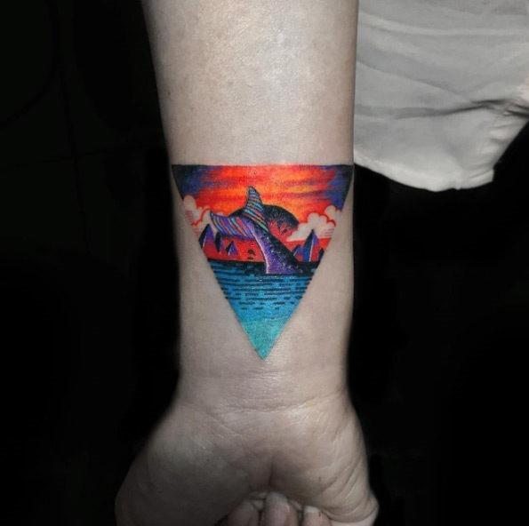 este_colorido_triangular_glifo