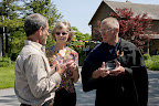 gathered group before walk, andy stern, eryl and wayman with bowls.jpg