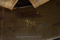 """The owner name """"Breuel"""" on the rear apron of the Steel Helmet"""