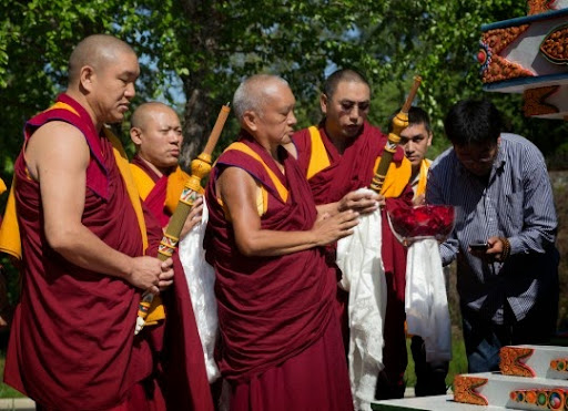 Lama Zopa Rinpoche blessing the Kadampa stupa with Geshe Gelek Chodha, Geshe Tenley and Geshe Sangpo at Kadampa Center, Raleigh, North Carolina, US, May 2014. Photo copyright David Strevel.