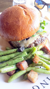 Avery Brewing Cheeseburger with ground chuck, smoked gouda, sherry greens, pickles, stout onions, and choice of a side (here you see pork belly green beans