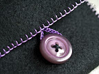 Purple Stitches and a Large Button for the Card Wallet