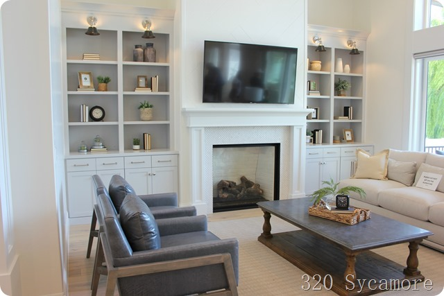 built ins with tv and tile fireplace