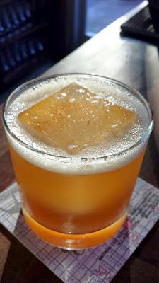 The famous Laurelhurst Market cocktail of Smoke Signals with Rye Whiskey, Sherry, Pecan, Lemon, Smoked Ice