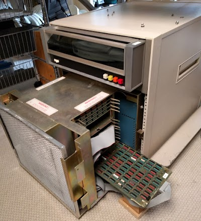 "The Ethernet card plugged into the Xerox Alto's chassis. The disk drive is above the chassis, with a white 14"" disk pack visible inside."