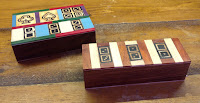Wooden boxes with dominoes, cards etc.