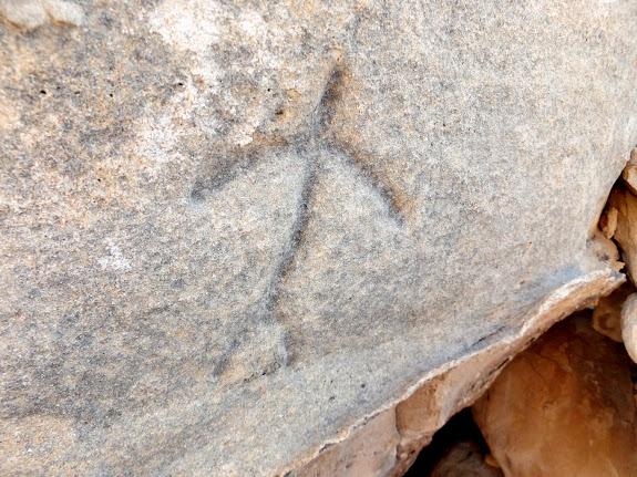 Deeply incised human figure