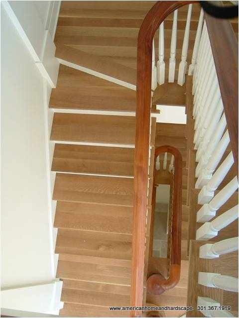 Wood tread spiral wood stair build project in Maryland