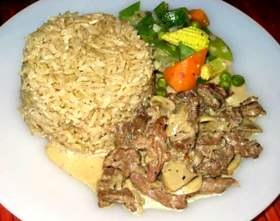 Beef and mushroom cooked in whole grain mustard sauce